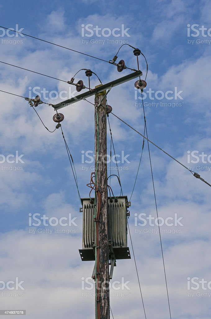 Wooden Power Electricity Pole Pylon,High Voltage,Blue Sky Background stock photo