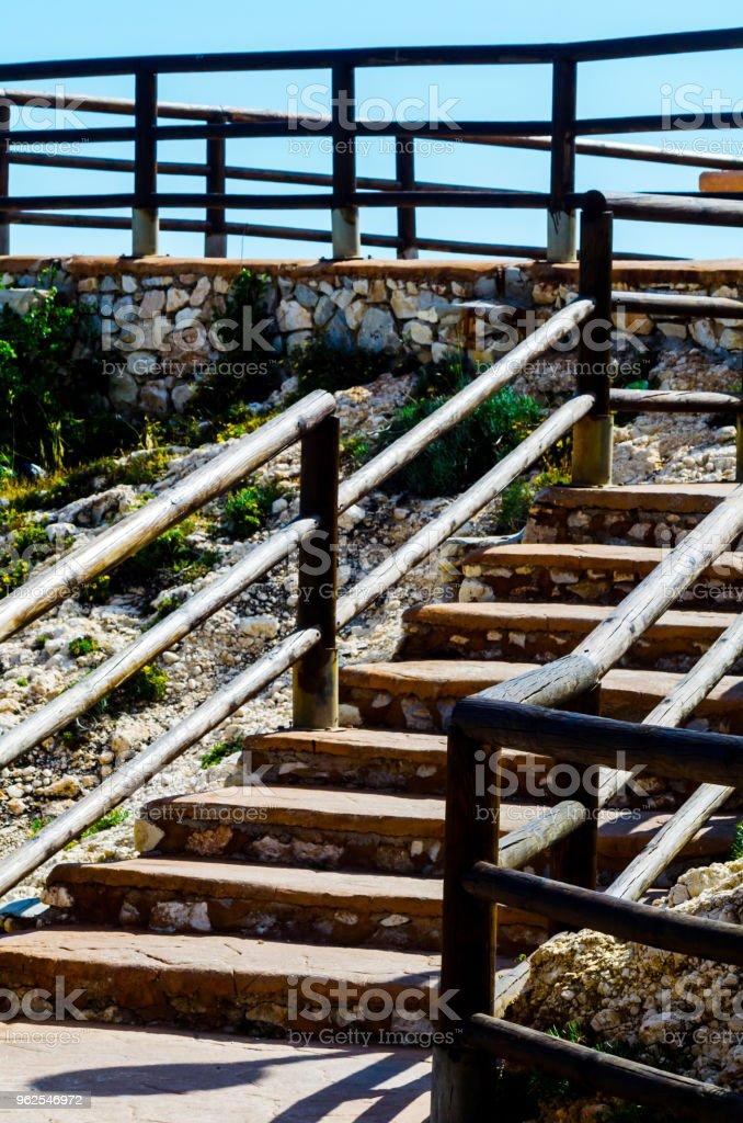 wooden promenade along the sea coast situated on a cliff rock in Rincon de la Victoria, Costa del Sol, Andalucja - Royalty-free Adventure Stock Photo