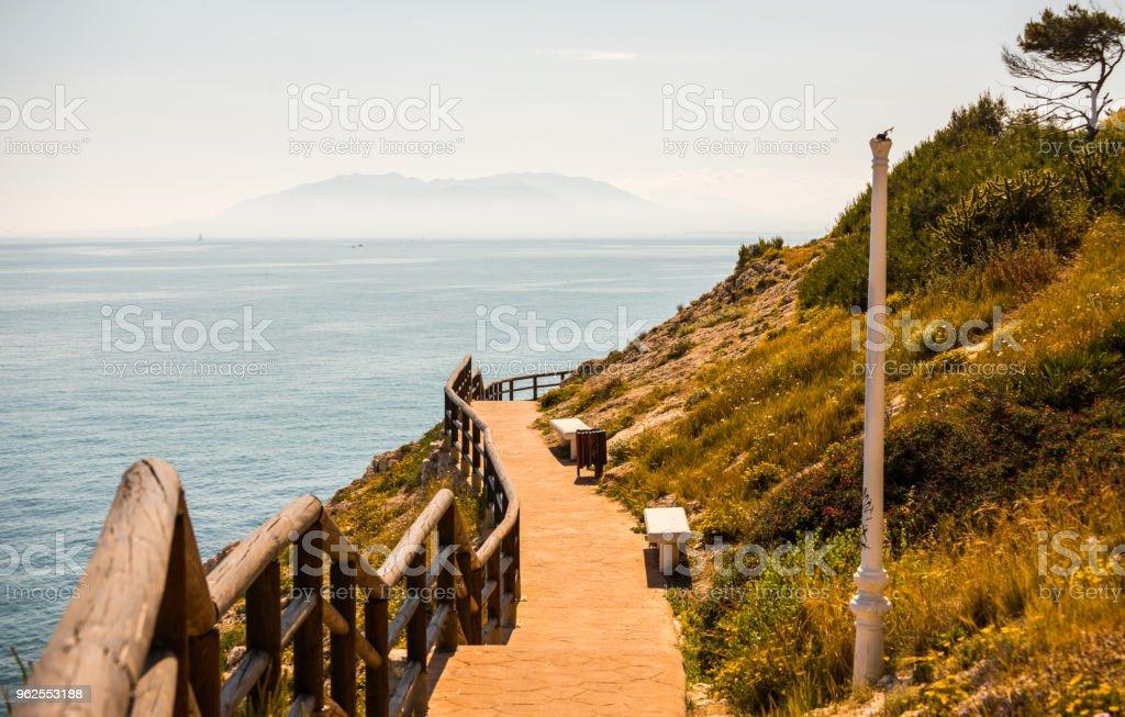 wooden promenade along the sea coast situated on a cliff rock in Rincon de la Victoria, Costa del Sol, Andalucja, - Royalty-free Adventure Stock Photo