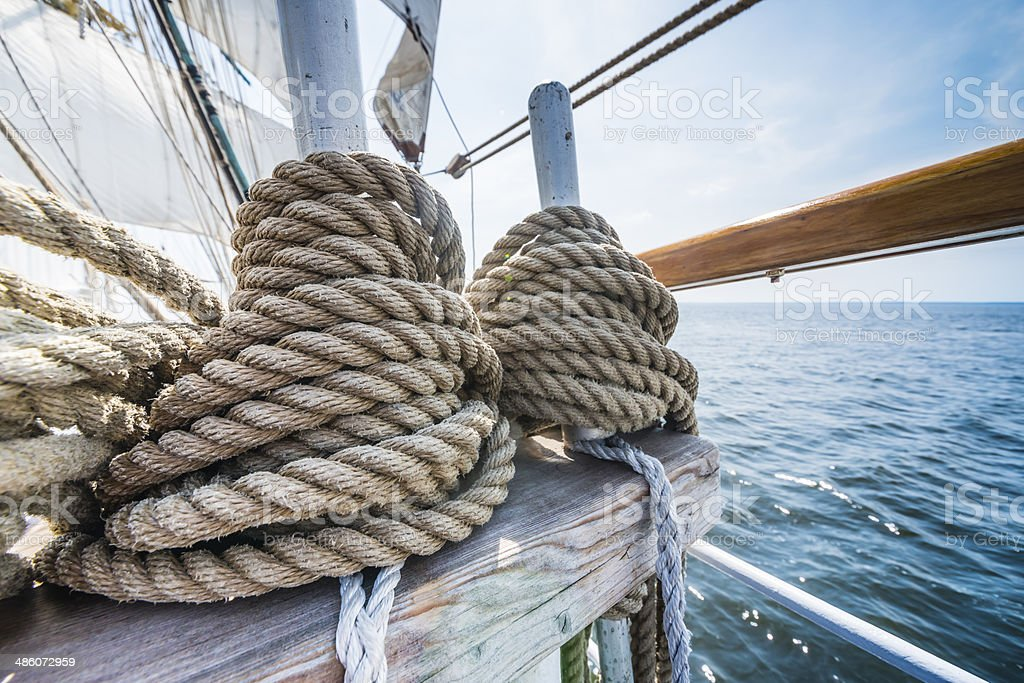 Wooden pulley and ropes on an old yacht. stock photo