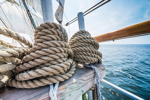 wooden pulley and ropes on an old yacht. - vintage nautical stock photos and pictures