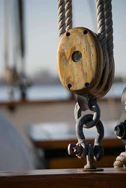 Wooden pulley on a tall ship stock photo
