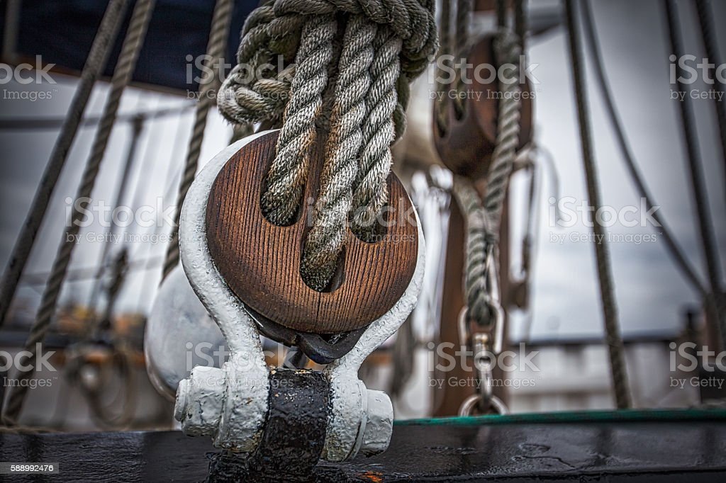 Wooden pulley on an old yacht stock photo