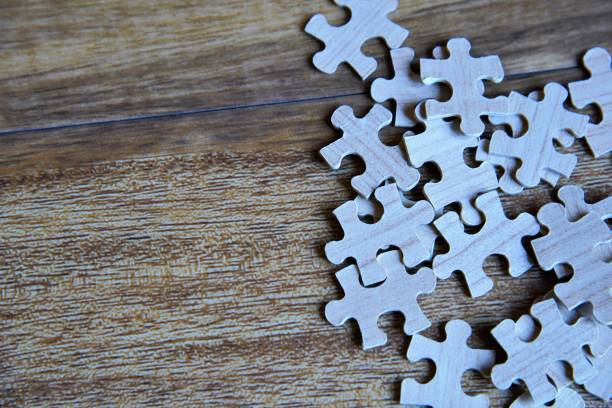 Wooden puzzle Pieces of unfinished puzzle. stock photo