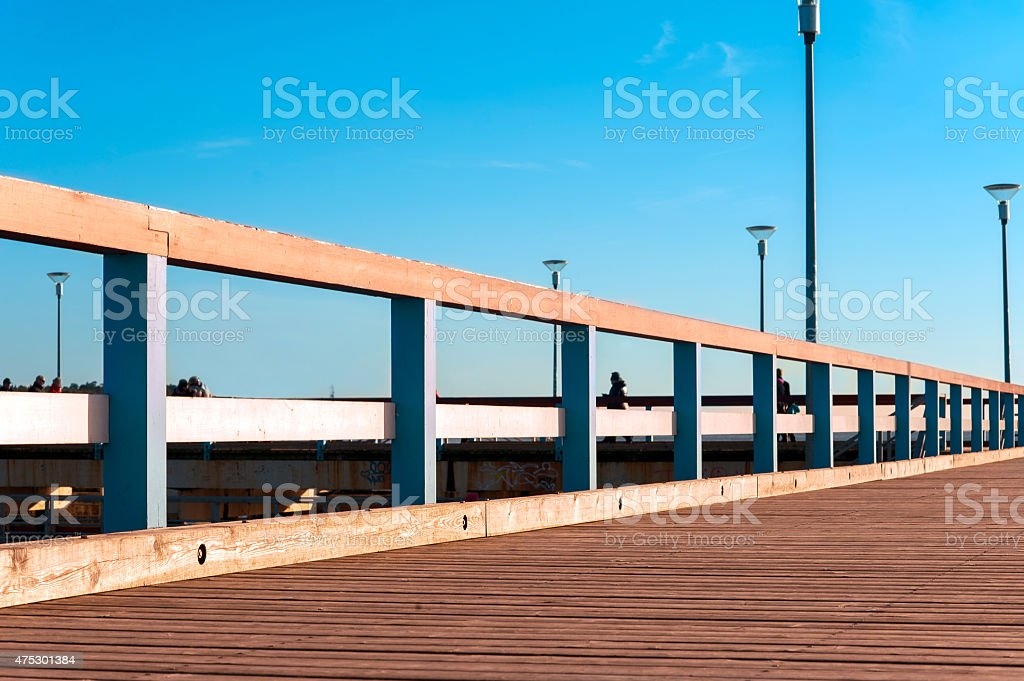 Wooden quayside in rays of evening sunlight. stock photo