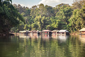 Tropical wooden raft building on river kwai in tropical rainforest at Kanchanaburi