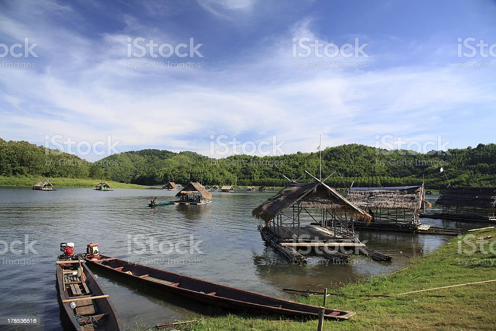 Wooden raft floating on the river royalty-free stock photo