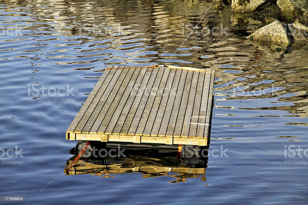Wooden raft on a fjord in Norway stock photo
