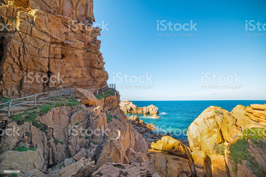 Wooden railing on the cliff royalty-free stock photo