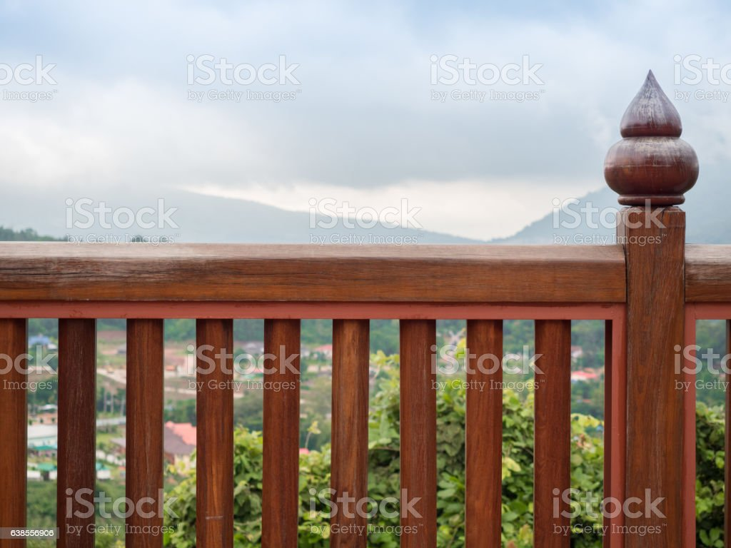 Wooden railings with a view of mountain stock photo