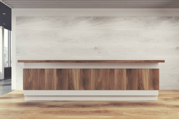 Wooden reception counter, close up Luxury office interior with lots of wood used in its decoration, a panoramic winow and a wooden reception counter near a white wall. Close up. 3d rendering mock up empty desk stock pictures, royalty-free photos & images
