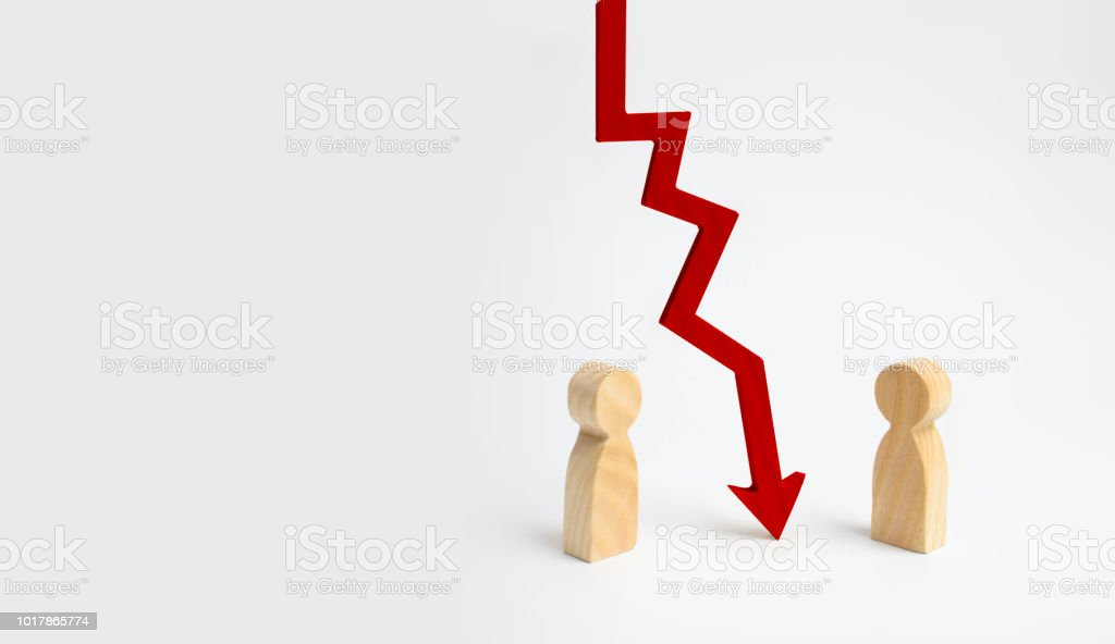 A wooden red chart arrow down divides the two people discussing the case. Termination and breakdown of relations, breaking ties. Contract break, conflict of interests. Negotiations of businessmen. stock photo