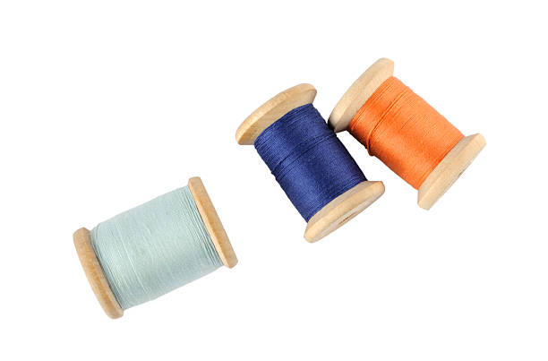 Wooden reels of thread Wooden reels of thread on white background spool stock pictures, royalty-free photos & images