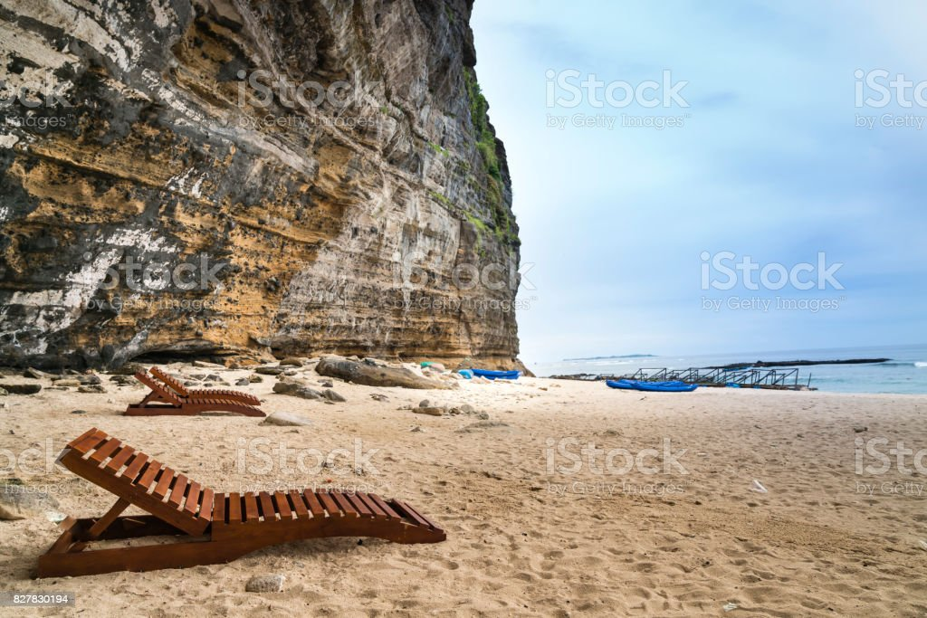 wooden relaxing chairs on sand at Hang Cau Beach stock photo