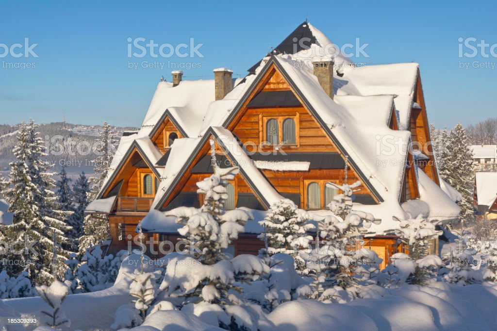 Wooden Residential House in winter stock photo