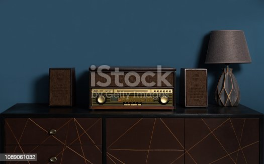 istock wooden retro style Music station with table lamp on wooden cabinet 1089061032