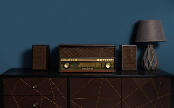 wooden retro style Music station with table lamp on wooden cabinet stock photo