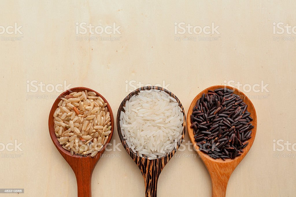 Wooden rice spoon on wood background stock photo
