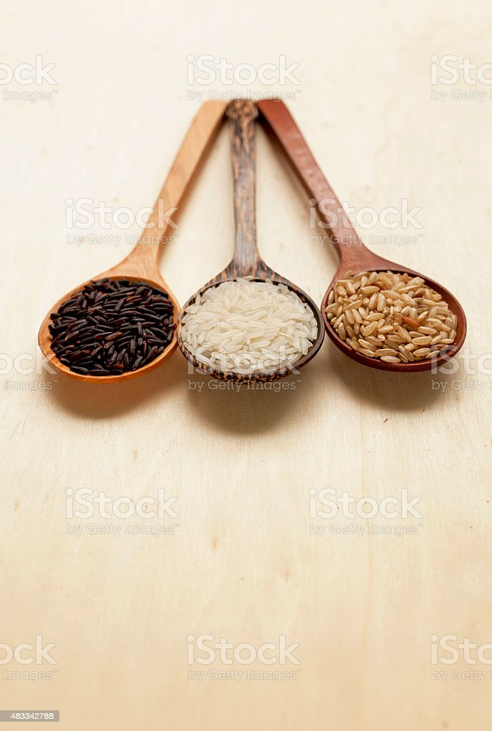 Wooden rice spoon with space on wood background stock photo