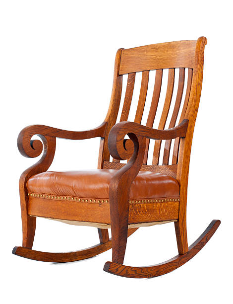 Wooden rocking chair standing against white background stock photo