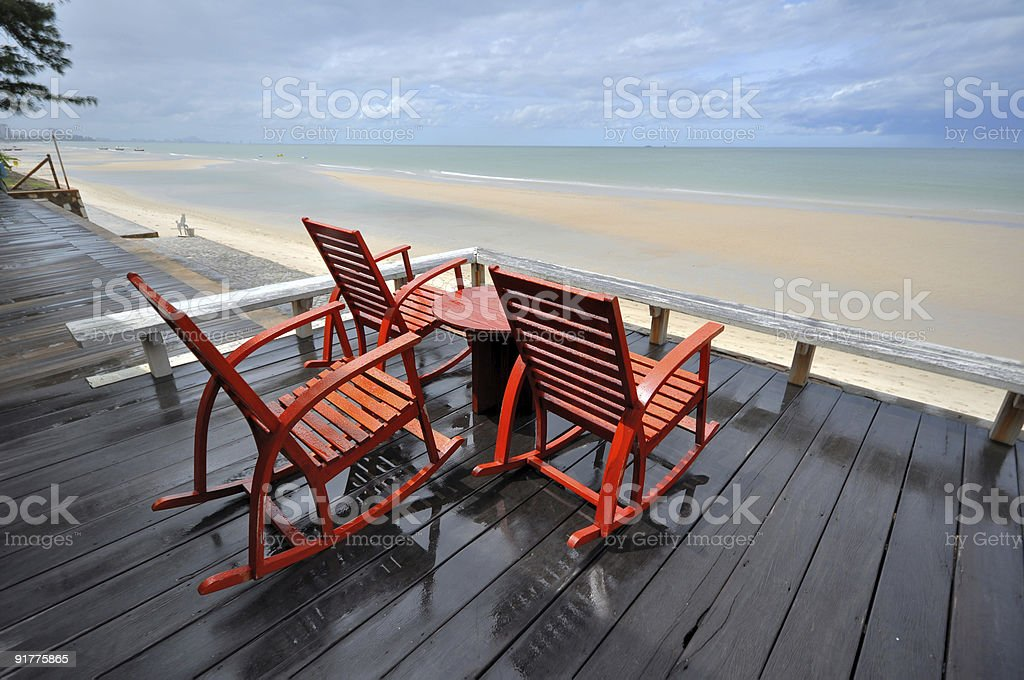 wooden rocking chairs, corridor, beach, seaside  Armchair Stock Photo