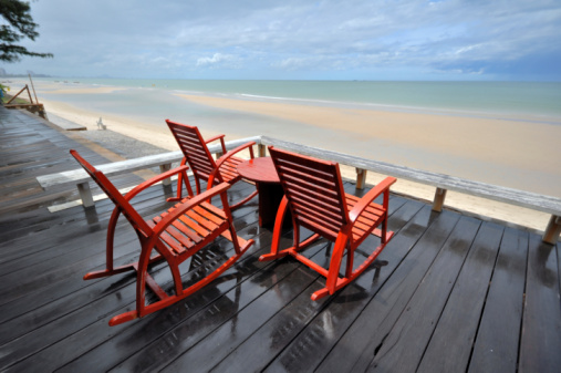Wooden Rocking Chairs Corridor Beach Seaside Stock Photo - Download Image Now
