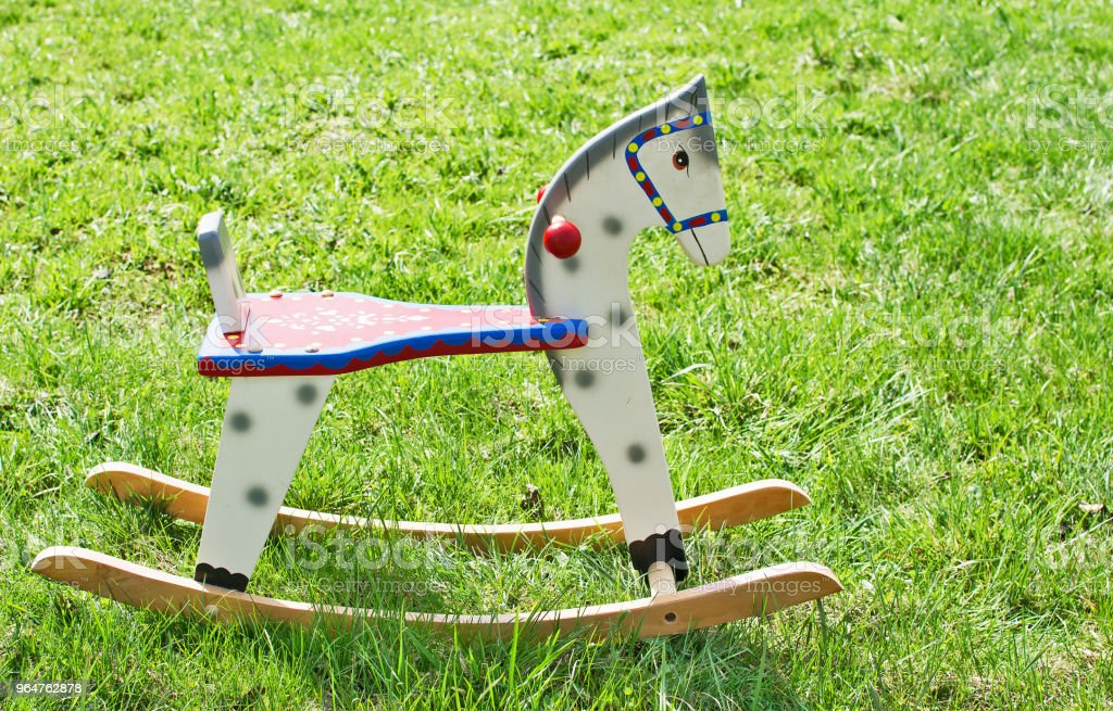 Wooden rocking horse on green grass royalty-free stock photo