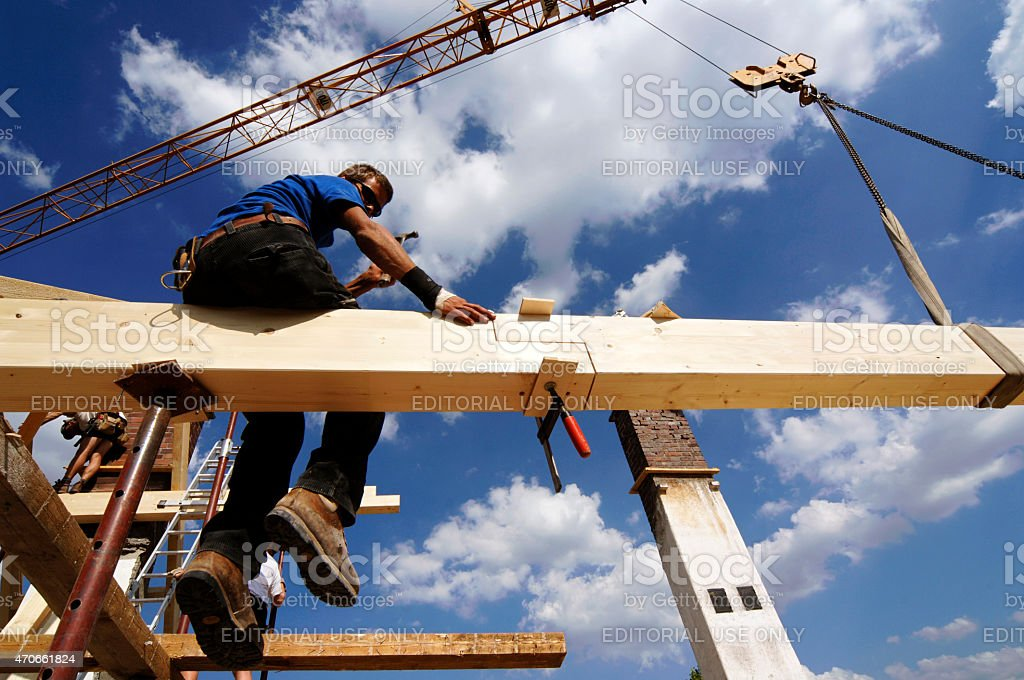 Wooden roof truss with blue sky stock photo