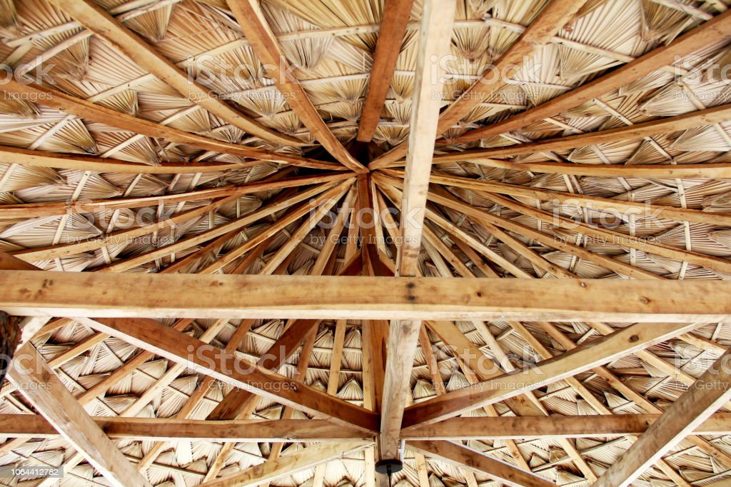 Wooden roofing frame and thatch, roof, thatched texture background. stock photo