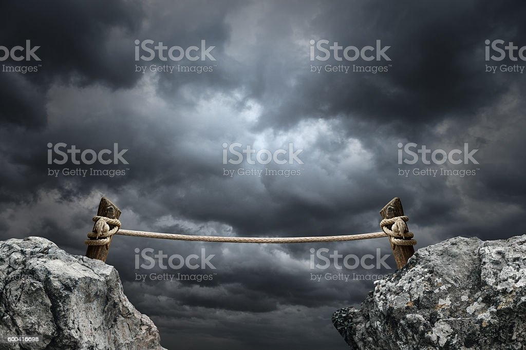 Wooden rope bridge in clouds stock photo