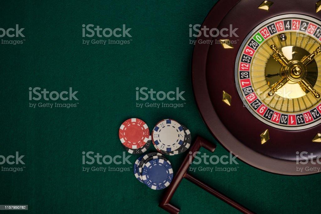 Wooden Roulette Drum on Green Casino Felt Table, Border BAckground,...