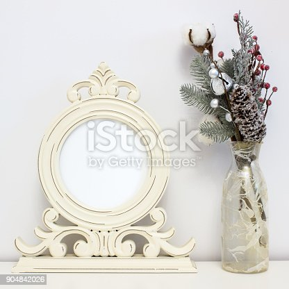 1136239089istockphoto Wooden round frame and winter decorations. White clear Mock-up for art work presentations 904842026