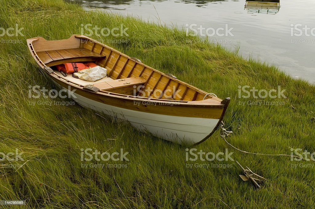 wooden rowboat in grass royalty-free stock photo