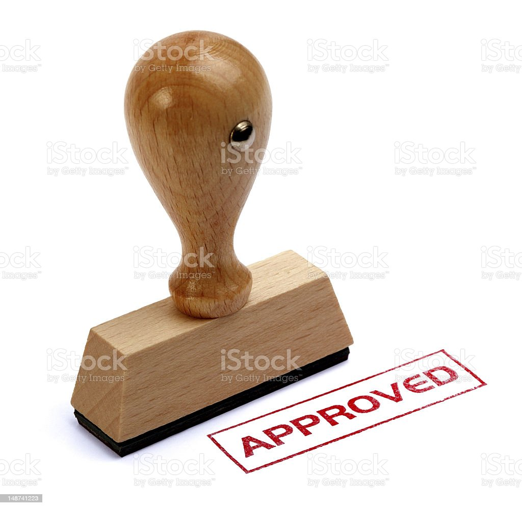 Wooden rubber stamp written approved stock photo