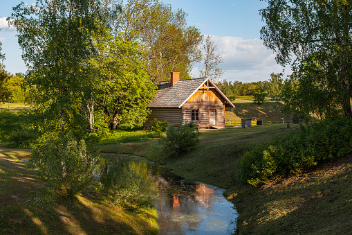 Wooden Rural House And Pond Latvian Countyside Stock Photo