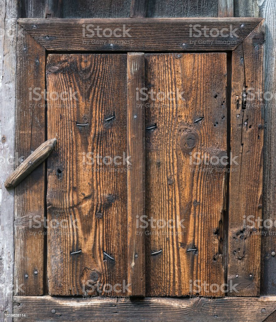 Wooden rustic wicket closed by a revolving lock stock photo