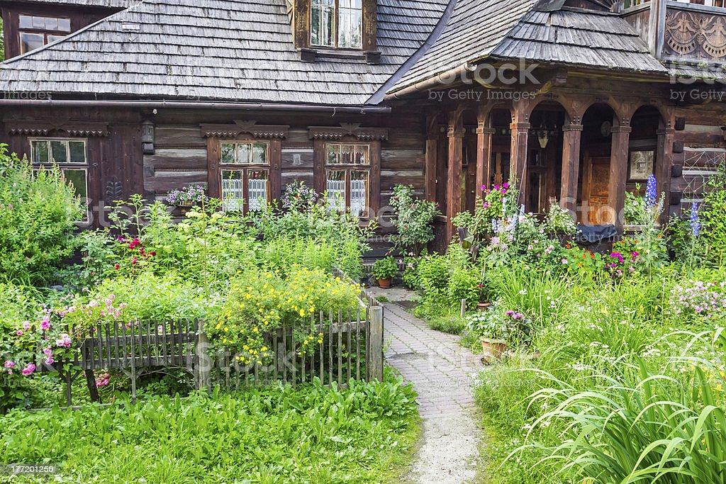 Wooden rustic wood house in the countryside royalty-free stock photo