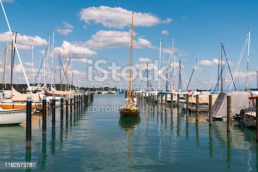 Konstanz, BW / Germany - 14. July 2019: wooden sailboat preparing to enter a berth in Konstanz harbor and docking