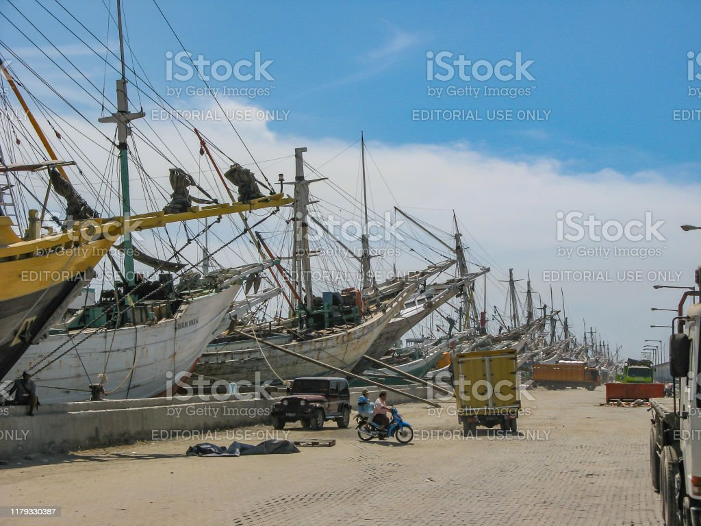 wooden sailing boats in an old harbour waiting for loading or unloading Jakarta, Indonesia - July 13, 2009: wooden sailing boats in an old harbour waiting for loading or unloading Asia Stock Photo