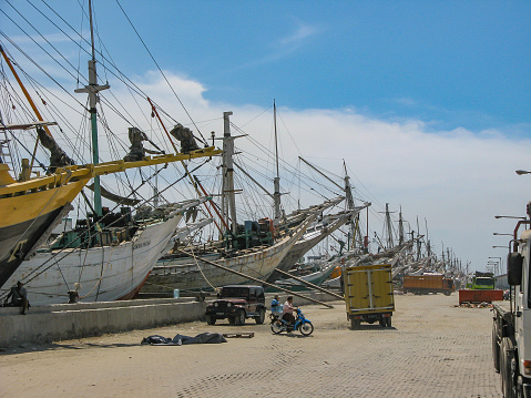 Wooden Sailing Boats In An Old Harbour Waiting For Loading Or Unloading Stock Photo - Download Image Now
