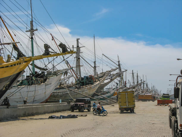 wooden sailing boats in an old harbour waiting for loading or unloading