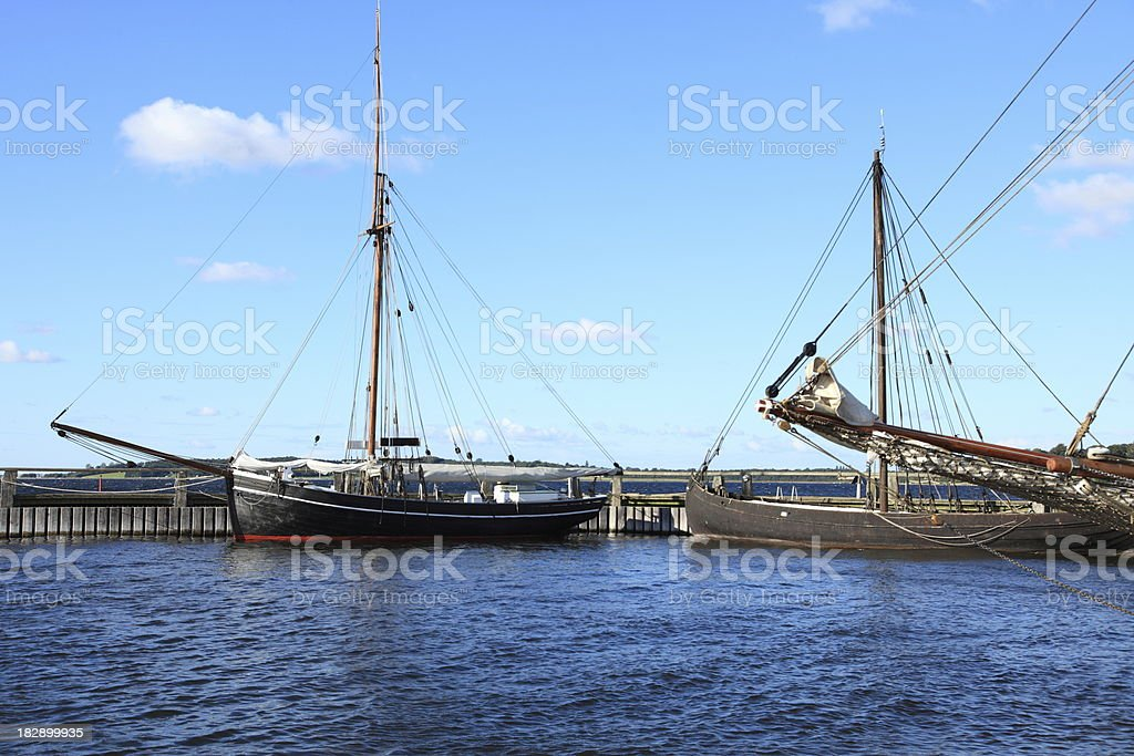Wooden sailing ships in Roskilde harbour stock photo