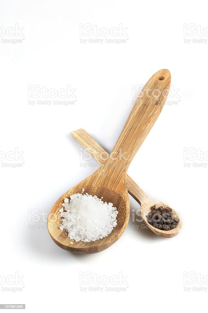 Wooden salt and pepper spoons  stock photo