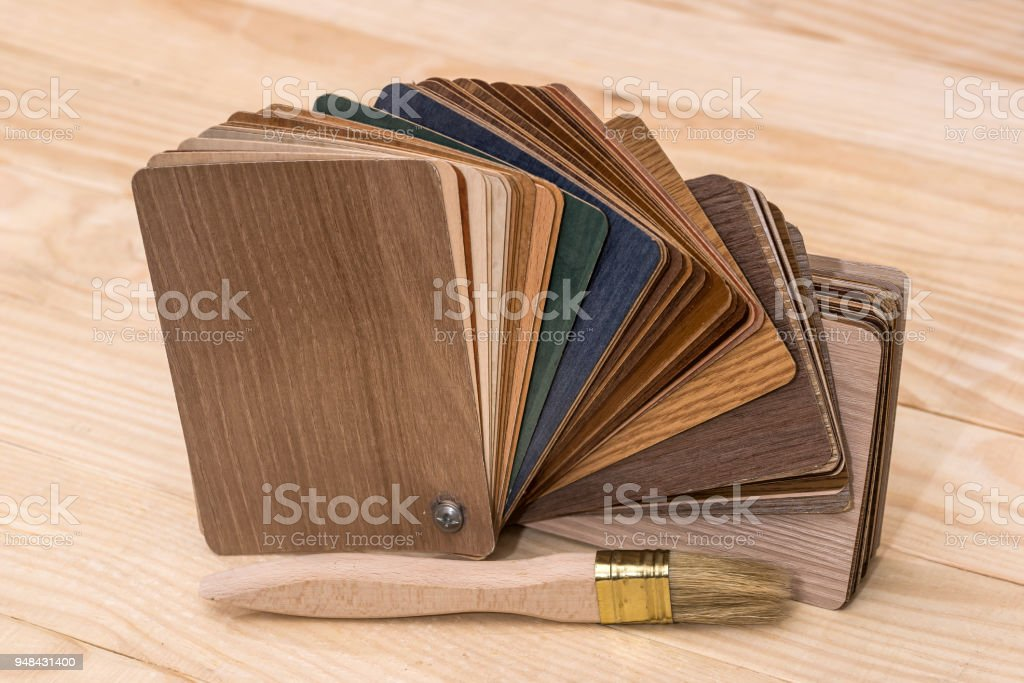 Wooden sampler for furniture decor with brush stock photo