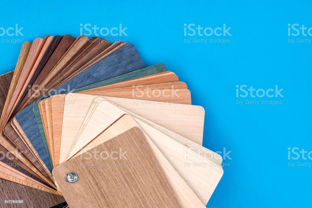 wooden samples isolated on blue background . stock photo