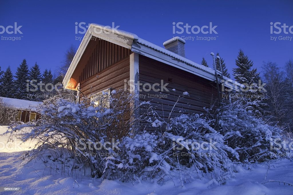 Wooden Sauna Hut in Winter Night royalty-free stock photo