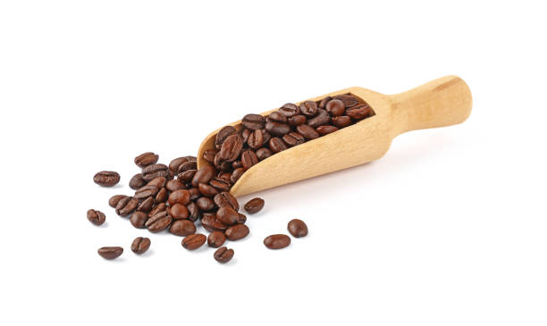 Wooden scoop of roasted coffee beans on white Close up wooden scoop full of roasted Arabica coffee beans isolated on white background, high angle view handful stock pictures, royalty-free photos & images