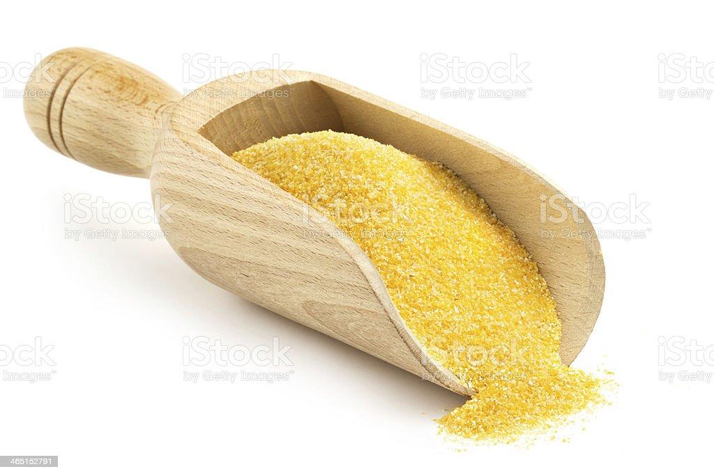 wooden scoop with corn flour stock photo
