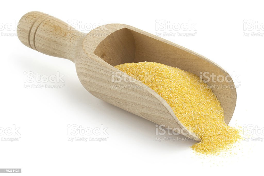wooden scoop with cornmeal stock photo