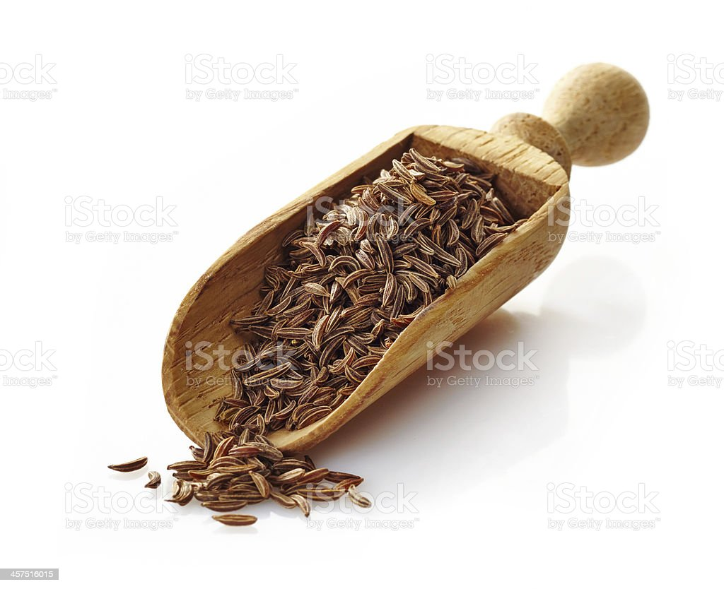wooden scoop with cumin stock photo